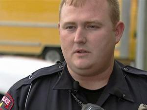 Smithfield police officer Thomas Lee is being credited with getting a family safely out of a burning house on Monday, July 13, 2009.