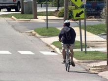 A bicyclist navigates the a roadway in the Triangle.