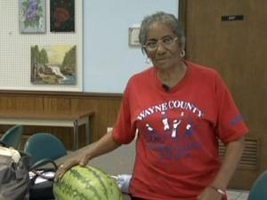 Seniors get produce from the Wayne County Senior Center in Goldsboro on Tuesday, July 21, 2009.