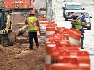 Construction crews work on Hillsborough Street in Raleigh on Aug. 1, 2009.
