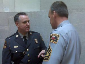 Col. Randy Glover, left, speaks with a state trooper on Aug. 7, 2009, shortly after Glover was sworn in as commander of the Highway Patrol.