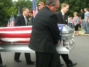 Men carry the casket of Pfc. Richard K. Jones, 21. (Photo by Will Okun)