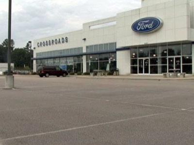 The lot at Crossroads Ford in Wake Forest is empty after many people have taken advantage of the cash for clunkers program.