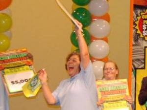 Darlen MacQuaide, of Fayetteville, celebrates after winning $50,000 a year for the rest of her life from the North Carolina Education Lottery in a drawing at WRAL-TV studios Wednesday, Aug. 13, 2009. (Photo courtesy of the North Carolina Education Lottery)