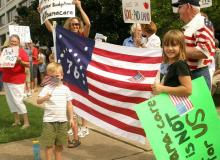 Opponents of a proposal to overhaul the nation's health care system protested outside of U.S. Sen. Kay Hagan's office in Raleigh on Aug. 14, 2009.