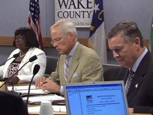 Wake County commissioners Lindy Brown, Paul Coble and Joe Bryan, left to right, expressed frustration with cost overruns at a planned area high school during an Aug. 17, 2009, meeting.