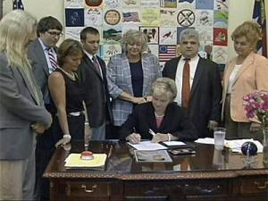 Gov. Bev Perdue signs a bill into law that toughens the sentence for people convicted of death by motor vechicle. She is surrounded by lawmakers and family members of two victims whose cases prompted the legislation.