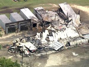 Sky 5 provides an aerial view of the damage to a Sampson County tobacco farm following an Aug. 26, 2009, fire.