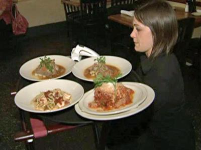 A server at 518 West on West Jones Street in Raleigh bring orders to a table on Aug. 27, 2009. This week was Downtown Raleigh Restaurant Week.