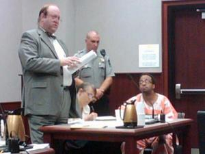 Robert Reaves, right, appears in a Wake County courtroom Aug. 28, 2009, with his attorneys Gerge Kelly (standing) and Margaret Lunden, center.