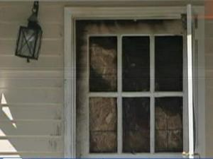 Fire damage can be seen on the exterior of Raleigh Mayor Charles Meeker's home.