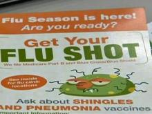 People get flu shots at drug stores