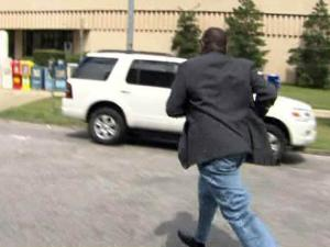 Kalu Kalu runs from a WRAL News camera on Sept. 8, 2009, after pleading guilty to Medicare fraud.