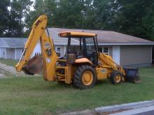 Heavy equipment sits outside Boone Street properties that Durham crews planned to demolish on Sept. 10, 2009, because they don't meet building codes.