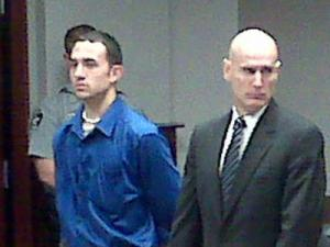 Justin Caleb Crouse, left, appears with his attorney in court Sept. 14 on a second-degree murder charge in the July 12, 2008, death of Lillian Broox Manis.