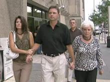 Raymond Dwight Cook leaves the Wake County Courthouse with his family Tuesday, Sept. 15, 2009.