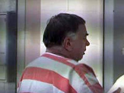 Vance Moore II is led back to the Wake County jail on Sept. 22, 2009. He is accused of operating a scam using ATM machines to defraud investors nationwide of $80 million.