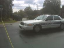 A police car blocked off the corner of Dartmouth and Briarcreek Place Friday afternoon in Fayetteville.