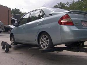 A car is towed on Hillsborough Street in Raleigh.