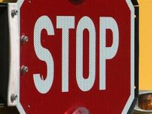 Stop-sign arm malfunction stalls bus
