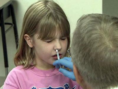 This child is given a dose of the FluMist vaccine for the H1N1 virus on Oct. 9, 2009.