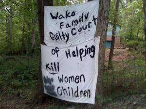 One of the signs Tonya Boykin has hung in front of her Raleigh home.