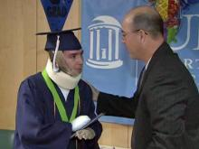 Union County burn victim graduates high school