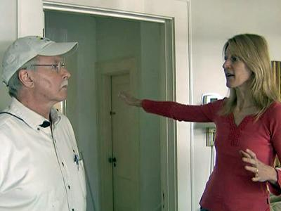 Sue Concannon talks with Tom Miller, an energy auditor for Durham County, about ways to conserve energy at her home.
