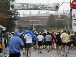 The last runners leave the starting line for the City of Oaks Marathon in Raleigh on Sunday, Nov. 1, 2009. (Photo by Thomas Babb)