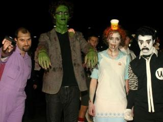 Alan Harvell (Jesus from the movie Big Lebowski), Matt Kershaw (Frankenstein), Katherine Kershaw (Zombie Wendy), and Matt Pierce (Ronald WackDonald) celebrate Halloween 2009 on Franklin Street in Chapel Hill.