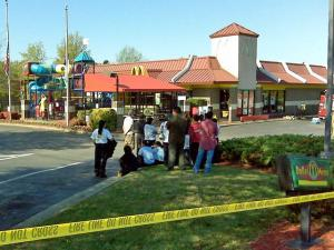Employees huddle in a parking lot after 31 people were exposed to a haz-mat situation at a McDonald's restaurant, 7141 Knightdale Blvd. in Knightdale, Sunday morning. Three were sent to local hospitals.