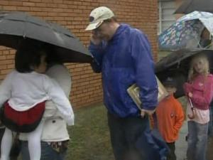 People lined up in the rain for H1N1 shots in Durham Wednesday.