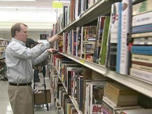 A man shops at Wake County Libraries' Annual Booksale in a former Winn-Dixie Supermarket in the South Station Shopping Center, 1514 Garner Station Blvd. in Raleigh, on Saturday, Nov. 14, 2009.
