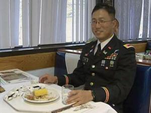 Army 1st Lt. Joe Cho enjoys an early Thanksgiving meal at Fort Bragg on Nov. 25, 2009.