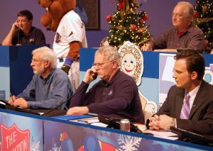 Volunteers take donors' phone calls during the WRAL Coats for Children telethon on Friday, Dec. 11, 2009. (Photo by Stacie Holyfield)