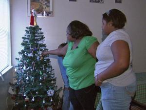 Nicole Benton decorates her Christmas tree.