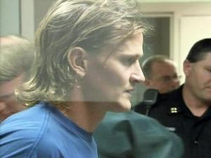 Jason Young appears before the Wake County magistrate to face charges of first-degree murder on Monday, Dec. 14, 2009.