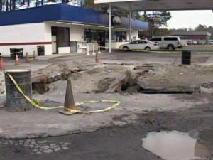 Slabs of concrete buckled and fell into a crater at the Exxon Short Stop on U.S. 1 in Moore County following a Dec. 15, 2009, explosion.