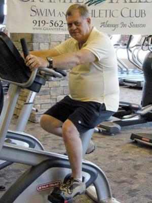 Rolesville Mayor Frank Eagles demonstrates his regular workout.