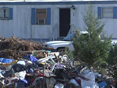 Residents in a Franklin County neighborhood near Louisburg have complained about a neighbor's cluttered yard, but the county says there's nothing it can do.
