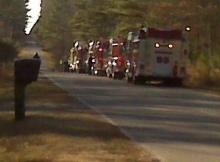 Fire trucks lined the road to welcome Robert Leffer and his family home on Friday.
