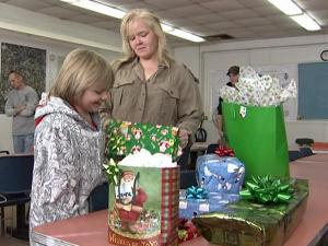 Tammy Pombo and her son, Tyler, open Christmas presents.
