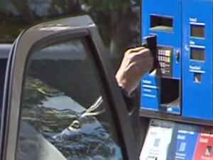 Criminals place skimming devices on card machines to collect data and create counterfeit cards.