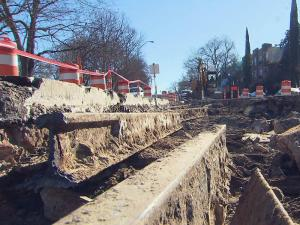 Crews installing a sewer line along Hillsborough Street found century-old streetcar tracks buried under the roadway.