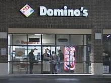 Police investigate a robbery and assault Saturday at the Domino's at 2001 Wide Waters Parkway, off Knightdale Boulevard, in Knightdale.