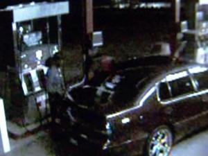 This image from a security camera at Paul's Grocery in Knightdale shows someone filling up for free after an accomplice used a master key to unlock the pump at night.