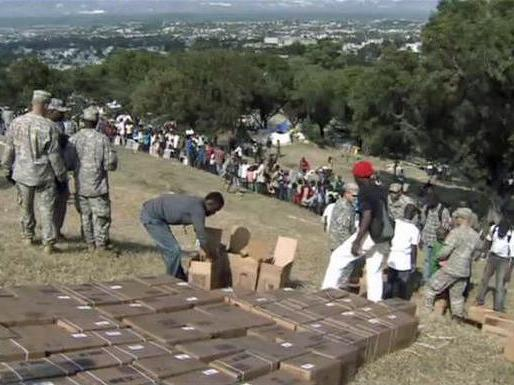 82nd Airborne paratroopers are running a supply distribution point on a hillside overlooking Port-au-Prince where 50,000 earthquake survivors have camped.