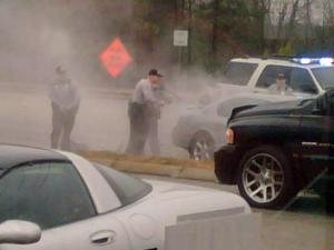 Apex police surround a car on N.C. 55 on Jan. 22, 2010, after a two-county chase that began as a domestic incident. (Photo courtesy of Jay Fry)
