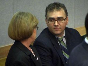 Portia Snead and Chad Lee chat during a courtroom break on Jan. 25, 2010. Both pleaded guilty to taking part in a Johnston County ticket-fixing case.