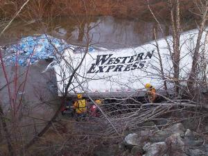 A tractor-trailer crashed on Interstate 85 South in Alamance County and went down an embankment into a river. (Photo courtesy of Justin Quesinberry/WFMY News 2)